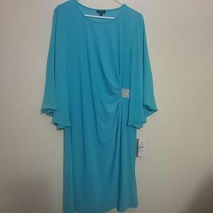 A light blue bell sleeve dress with rhinestones